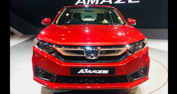Honda Cars India has unveiled the new 2018 Amazon at Auto Expo 2018. The car is expected to come in market in coming months. It is based on a new platform and borrows styling cues from Honda's latest sedans. Now it rides on 15-inch wheels compared to the 14 inchers offered in current model. The overall look looks like miniature tenth-gen Accord. It will be available in 1.2-litre i-VTEC petrol engine offering 87 Bhp Power and 109Nm Torque. The diesel model will be packed with 1.5-litre i-DTEC Engine offering 98.6 Bhp Power and 200Nm Torque. Both Petrol and Diesel model will use 5-speed gearbox. The Fuel efficiency of Petrol model is claimed to be 17.8 kmpl and 25.8 kmpl for diesel model. It has new 7 inch Digipad touchscreen offering smartphone integration, navigation and a host of other features. It will continue to fight with third-gen Maruti Suzuki Dzire launched in India back in May 2017. Other competitors include Hyundai Xcent, VW Ameo, Tata's Tigor and Zest and Ford Figo Aspire,